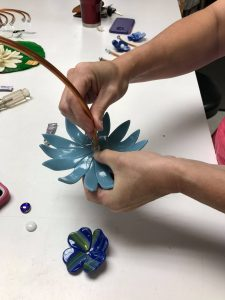 Student Assembling Fused flowers - Fused Flowers Class