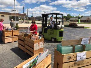 Fork truck moving crates parking lot sales 2017-spring