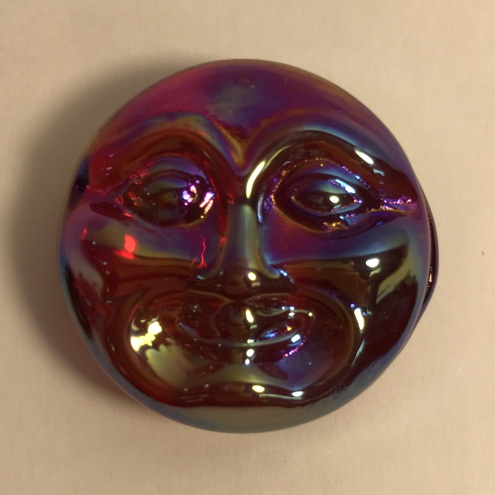 Red irridized glass moon face
