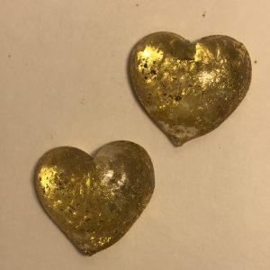 Tiny gold glass hearts