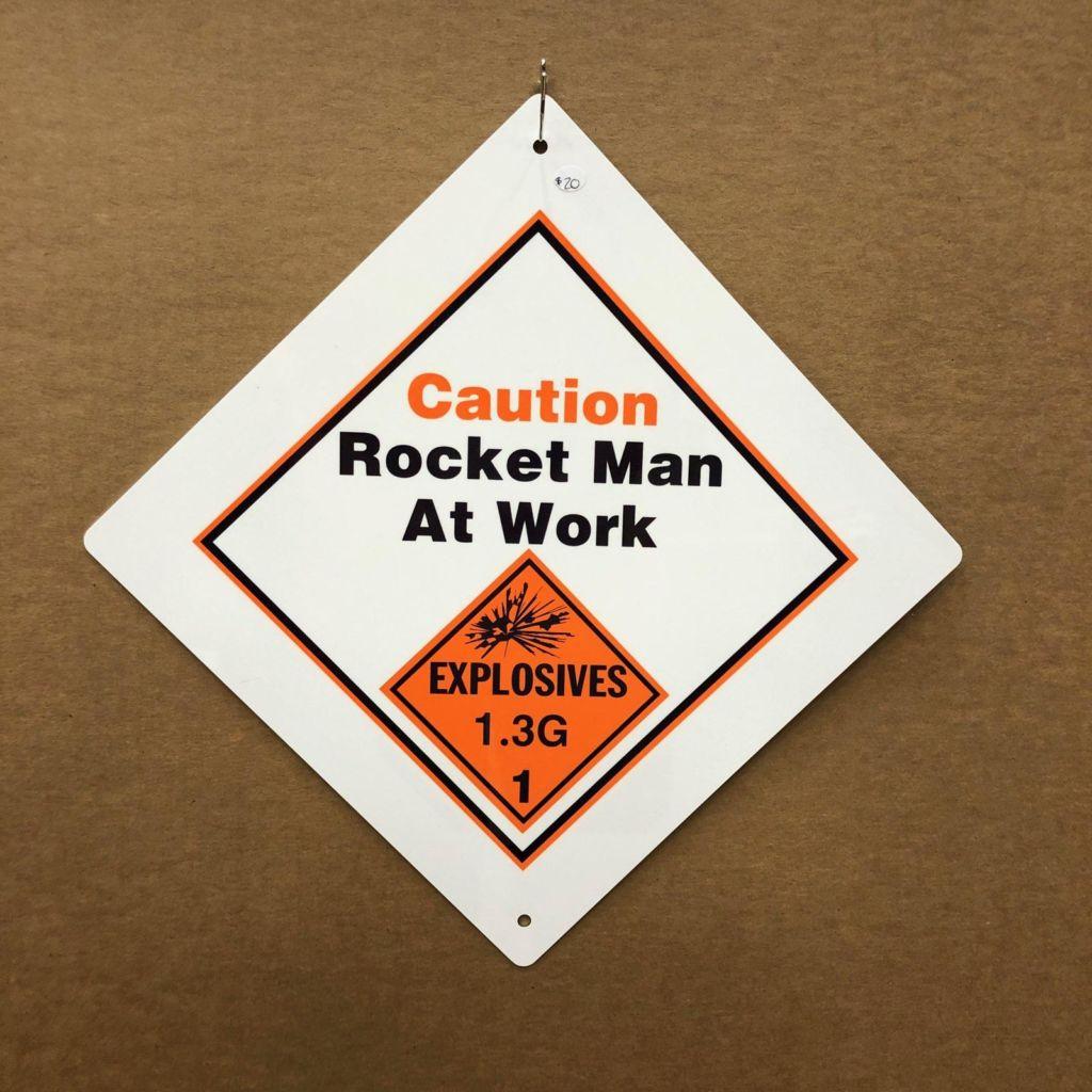 Caution Rocket Man at Work Sign